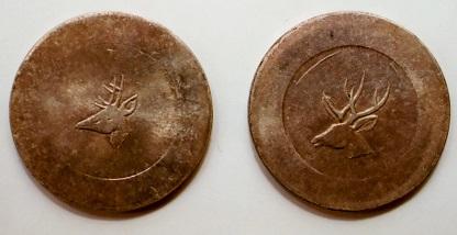 阿片取引用の1両銀貨 小さい鹿の頭(左)と大きい鹿の頭