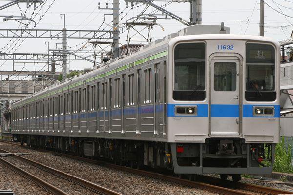 11632F