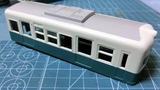 クリームと青緑のツートンカラーになった琴電1300形⑤